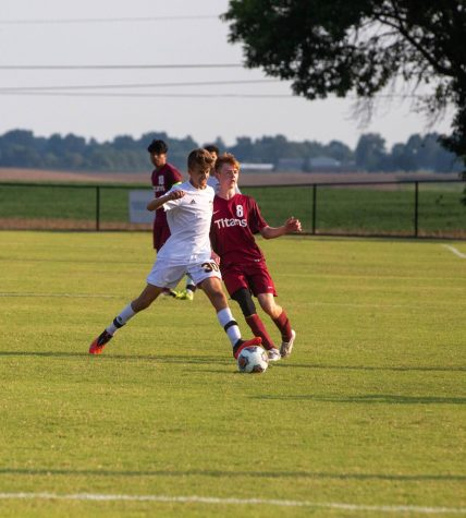 Jake Romerhausen passes the ball to an open midfielder.