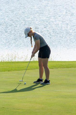Senior Hillary Humbaugh concentrates on her putt at a regular season match against Vincennes Rivet.