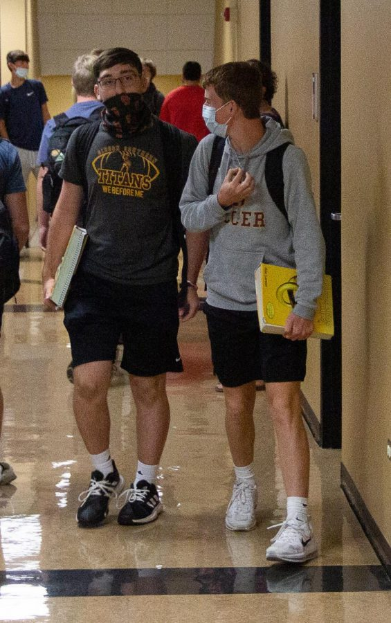 Seniors Cole Jones and Christian Eichmiller keep their masks on throughout the day, until theyre in a room where they can socially distance by six feet or more.